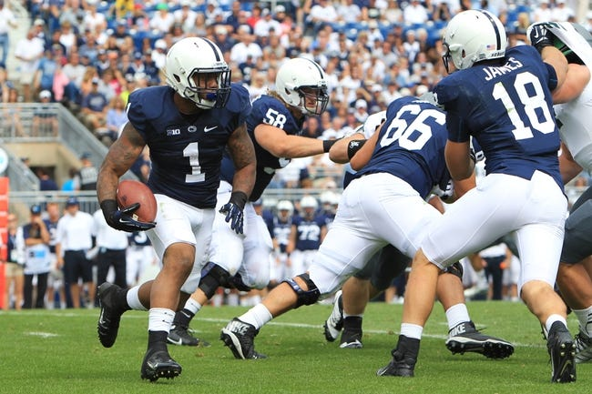 Sep 7, 2013; University Park, PA, USA; Penn State Nittany Lions running back Bill Belton (1) runs the ball during the fourth quarter against the Eastern Michigan Eagles at Beaver Stadium. Penn State defeated Eastern Michigan 45-7. Mandatory Credit: Matthew O'Haren-USA TODAY Sports