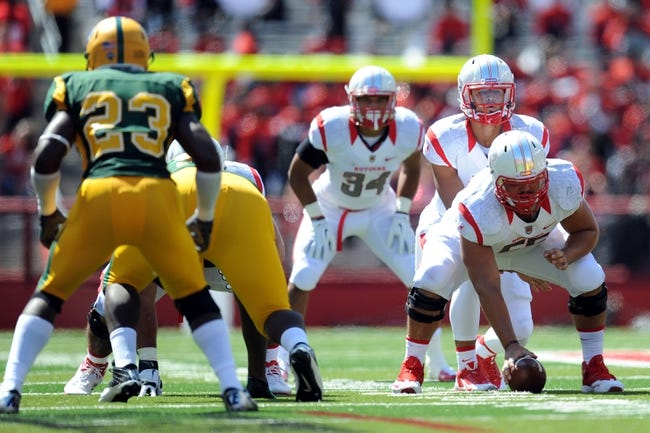 Sep 7, 2013; Piscataway, NJ, USA; Rutgers Scarlet Knights quarterback Gary Nova (10) calls a play at the line of a scrimmage against the Norfolk State Spartans during the first half at High Point Solutions Stadium. Rutgers won the game 38-0. Mandatory Credit: Joe Camporeale-USA TODAY Sports