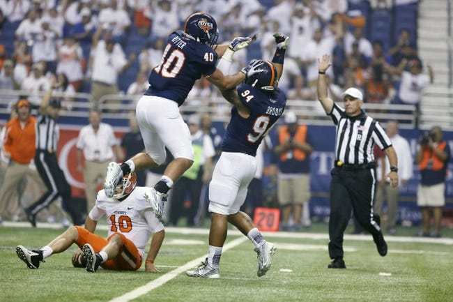 Sep 7, 2013; San Antonio, TX, USA; Texas-San Antonio Roadrunners defensive end Brooks, Codie (right) reacts with Ritter, Will (left) after a sack against the Oklahoma State Cowboys during the second half  at Alamodome. Oklahoma State Cowboys beat Texas-San Antonio Roadrunners 56-35. Mandatory Credit: Soobum Im-USA TODAY Sports