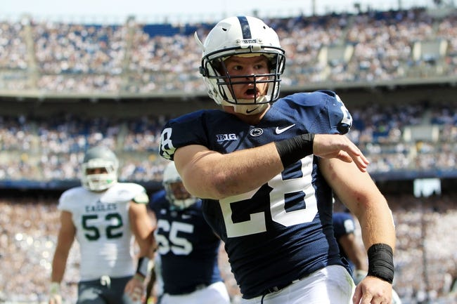 Sep 7, 2013; University Park, PA, USA; Penn State Nittany Lions running back Zach Zwinak (28) reacts after scoring a touchdown during the third quarter against the Eastern Michigan Eagles at Beaver Stadium. Penn State defeated Eastern Michigan 45-7. Mandatory Credit: Matthew O'Haren-USA TODAY Sports