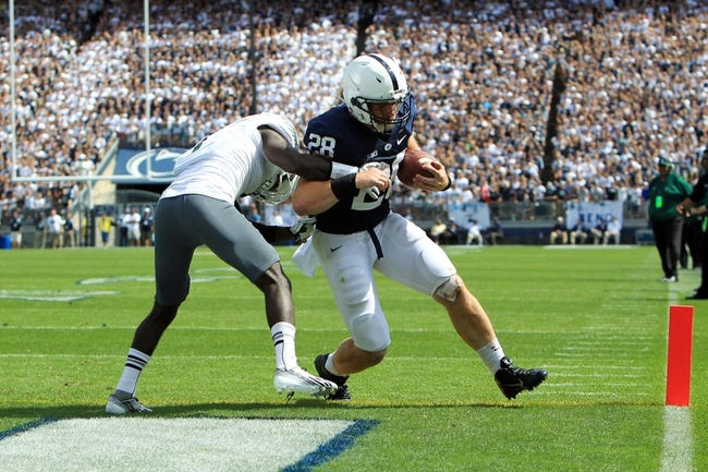 Sep 7, 2013; University Park, PA, USA; Penn State Nittany Lions running back Zach Zwinak (28) runs the ball into the end zone for a touchdown during the third quarter against the Eastern Michigan Eagles at Beaver Stadium. Penn State defeated Eastern Michigan 45-7. Mandatory Credit: Matthew O'Haren-USA TODAY Sports