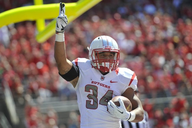 Sep 7, 2013; Piscataway, NJ, USA; Rutgers Scarlet Knights running back Paul James (34) celebrates a touchdown against the Norfolk State Spartans during the first half at High Point Solutions Stadium. Rutgers won the game 38-0. Mandatory Credit: Joe Camporeale-USA TODAY Sports