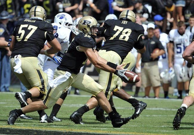 Sep 7, 2013; West Lafayette, IN, USA; Purdue Boilermakers quarterback Rob Henry (15) hands off against the Indiana State Sycamores in the 2nd half at Ross Ade Stadium. Mandatory Credit: Sandra Dukes-USA TODAY Sports