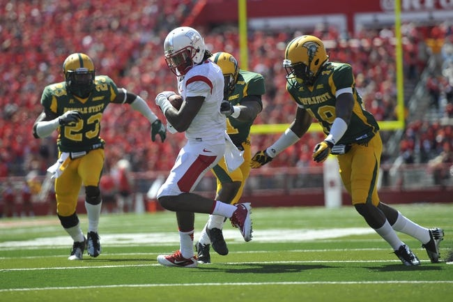 Sep 7, 2013; Piscataway, NJ, USA; Rutgers Scarlet Knights wide receiver Quron Pratt (7) runs after making a catch against the Norfolk State Spartans during the first half at High Point Solutions Stadium. Rutgers won the game 38-0. Mandatory Credit: Joe Camporeale-USA TODAY Sports