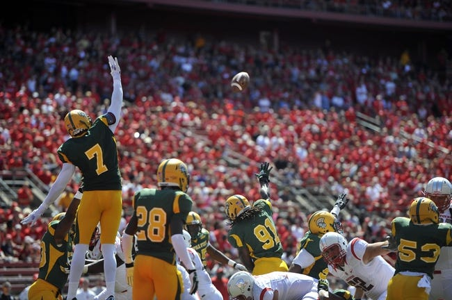 Sep 7, 2013; Piscataway, NJ, USA; Norfolk State Spartans players attempt to block an extra point by the Rutgers Scarlet Knights during the first half at High Point Solutions Stadium. Rutgers won the game 38-0. Mandatory Credit: Joe Camporeale-USA TODAY Sports