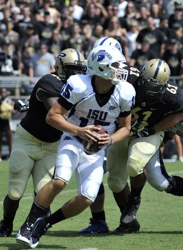 Sep 7, 2013; West Lafayette, IN, USA;  Indiana State Sycamores quarterback Mike Perish (15) looks to pass as Purdue Boilermakers defensive tackle Ryan Isaac (61) closes in in the 2nd half at Ross Ade Stadium. Mandatory Credit: Sandra Dukes-USA TODAY Sports