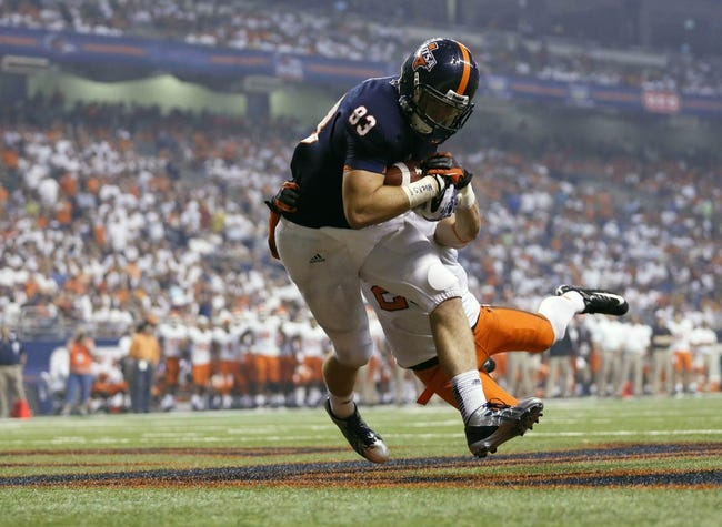 Sep 7, 2013; San Antonio, TX, USA; Texas-San Antonio Roadrunners tight end Hubble, Cole (83) makes a touchdown catch as Oklahoma State Cowboys safety Craig, Zack (23) defends during the second half  at Alamodome. Oklahoma State Cowboys beat Texas-San Antonio Roadrunners 56-35. Mandatory Credit: Soobum Im-USA TODAY Sports