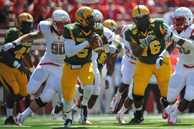 Sep 7, 2013; Piscataway, NJ, USA; Norfolk State Spartans quarterback Malik Stokes (5) scrambles against the Rutgers Scarlet Knights during the first half at High Point Solutions Stadium. Rutgers won the game 38-0. Mandatory Credit: Joe Camporeale-USA TODAY Sports