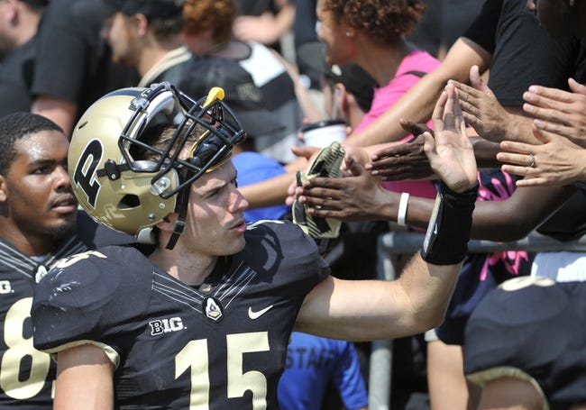 Sep 7, 2013; West Lafayette, IN, USA;  Purdue Boilermakers quarterback Rob Henry (15) slaps hands with the fans after the game against the Indiana State Sycamores at Ross Ade Stadium. Mandatory Credit: Sandra Dukes-USA TODAY Sports