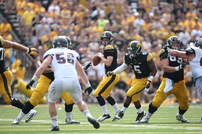 Sep 7, 2013; Iowa City, IA, USA; Iowa Hawkeyes quarterback Jake Rudock (15) drops back to pass against the Missouri State Bears at Kinnick Stadium.  Iowa beat Missouri State 28-14.  Mandatory Credit: Reese Strickland-USA TODAY Sports