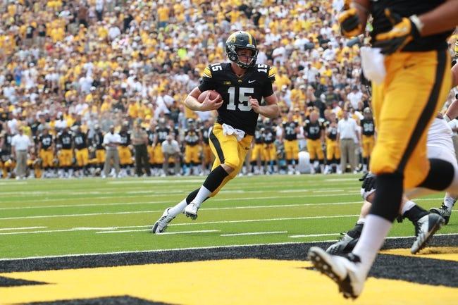 Sep 7, 2013; Iowa City, IA, USA; Iowa Hawkeyes quarterback Jake Rudock (15) runs in for the touchdown against the Missouri State Bears at Kinnick Stadium.  Iowa beat Missouri State 28-14.  Mandatory Credit: Reese Strickland-USA TODAY Sports