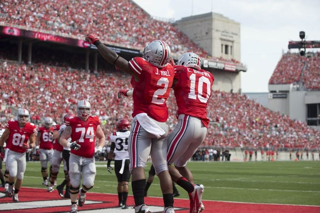 Sep 7, 2013; Columbus, OH, USA; Ohio State Buckeyes running back Jordan Hall (2) and wide receiver Philly Brown (10) celebrate after Hall scored against the San Diego State Aztecs at Ohio Stadium. Mandatory Credit: Greg Bartram-USA TODAY Sports