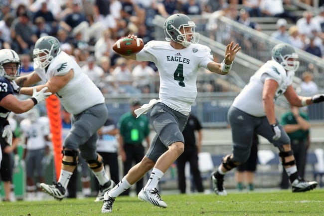 Sep 7, 2013; University Park, PA, USA; Eastern Michigan Eagles quarterback Brogan Roback (4) attempts to throw a pass during the fourth quarter against the Penn State Nittany Lions at Beaver Stadium. Penn State defeated Eastern Michigan 45-7. Mandatory Credit: Matthew O'Haren-USA TODAY Sports