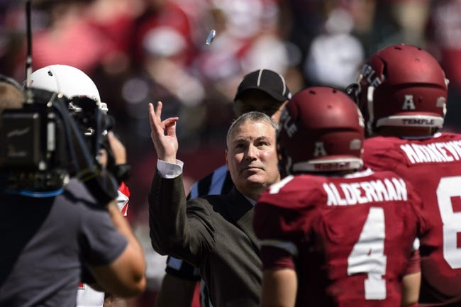 Sep 7, 2013; Philadelphia, PA, USA; American Athletic Conference Commissioner Mike Aresco flips a coin prior to the start of the game between the Temple Owls and the Houston Cougars at Lincoln Financial Field. Houston defeated temple 22-13. Mandatory Credit: Howard Smith-USA TODAY Sports