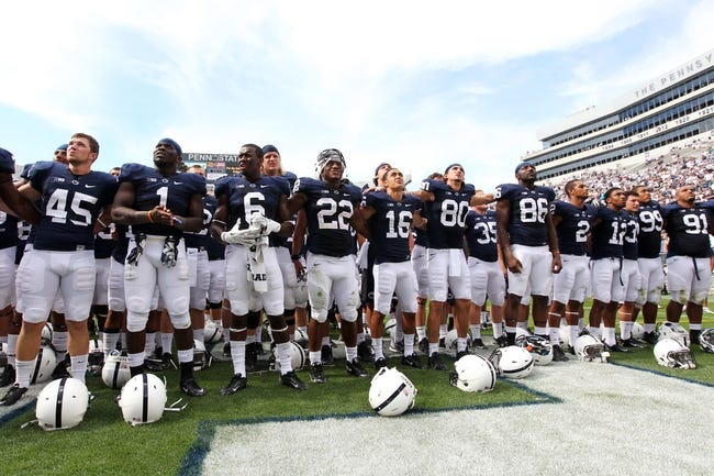 Sep 7, 2013; University Park, PA, USA; Penn State Nittany Lions players sing the alma mater following the completion of the game against the Eastern Michigan Eagles at Beaver Stadium. Penn State defeated Eastern Michigan 45-7. Mandatory Credit: Matthew O'Haren-USA TODAY Sports
