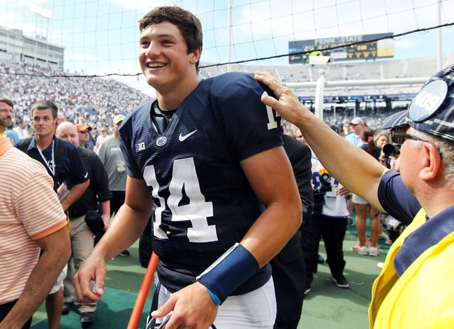 Sep 7, 2013; University Park, PA, USA; Penn State Nittany Lions quarterback Christian Hackenberg (14) walks off the field following the completion of the game against the Eastern Michigan Eagles at Beaver Stadium. Penn State defeated Eastern Michigan 45-7. Mandatory Credit: Matthew O'Haren-USA TODAY Sports