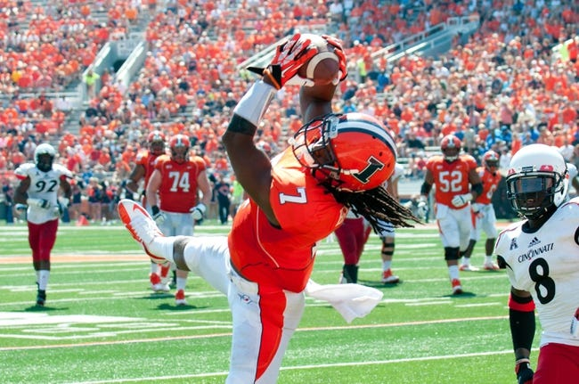 Sep 7, 2013; Champaign, IL, USA;  Illinois Fighting Illini wide receiver Martize Barr (7) makes a touchdown reception during the fourth quarter against the Cincinnati Bearcats at Memorial Stadium. Illinois won 45-17.  Mandatory Credit: Bradley Leeb-USA TODAY Sports