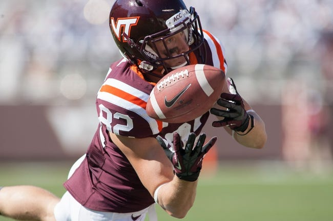 Sep 7, 2013; Blacksburg, VA, USA; Virginia Tech Hokies wide receiver Willie Byrn (82) catches a pass during the third quarter against the Western Carolina Catamounts at Lane Stadium. Virginia Tech defeated Western Carolina 45-3. Mandatory Credit: Jeremy Brevard-USA TODAY Sports