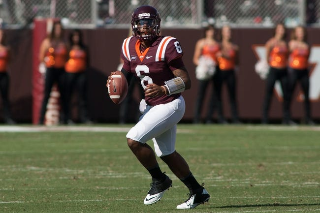 Sep 7, 2013; Blacksburg, VA, USA; Virginia Tech Hokies quarterback Mark Leal (6) rolls out of the pocket during the fourth quarter against the Western Carolina Catamounts at Lane Stadium. Virginia Tech defeated Western Carolina 45-3. Mandatory Credit: Jeremy Brevard-USA TODAY Sports