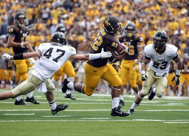 Sep 7, 2013; Laramie, WY, USA; Wyoming Cowboys running back Tedder Easton (22) scores a touchdown against Idaho Vandals cornerback Jordan Grabski (47) during the second quarter at War Memorial Stadium. Mandatory Credit: Troy Babbitt-USA TODAY Sports