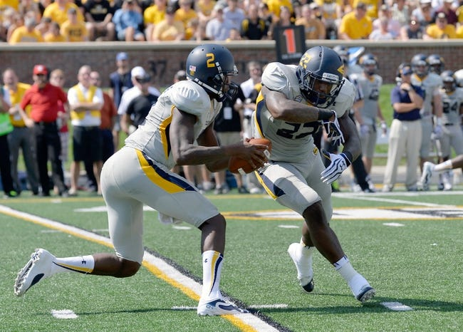 Sep 7, 2013; Columbia, MO, USA;  Toledo Rockets quarterback Terrance Owens (2) hands off to Toledo Rockets running back David Fluellen (22) during the first half against the Missouri Tigers  at Faurot Field. Mandatory Credit: Jasen Vinlove-USA TODAY Sports