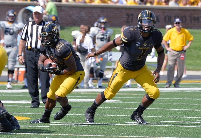 Sep 7, 2013; Columbia, MO, USA;  Missouri Tigers quarterback James Franklin (1) hands off to Missouri Tigers running back Henry Josey (20) during the first half at Faurot Field. Mandatory Credit: Jasen Vinlove-USA TODAY Sports