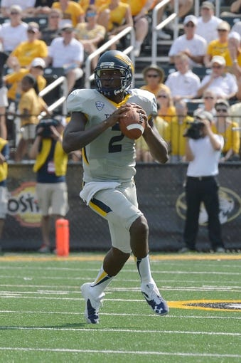 Sep 7, 2013; Columbia, MO, USA; Toledo Rockets quarterback Terrance Owens (2) looks to make a pass  against the Missouri Tigers during the first half at Faurot Field. Mandatory Credit: Jasen Vinlove-USA TODAY Sports