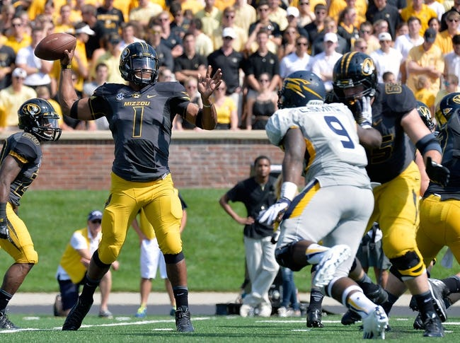 Sep 7, 2013; Columbia, MO, USA; Missouri Tigers quarterback James Franklin (1) makes a pass during the first half against the Toledo Rockets at Faurot Field. Mandatory Credit: Jasen Vinlove-USA TODAY Sports