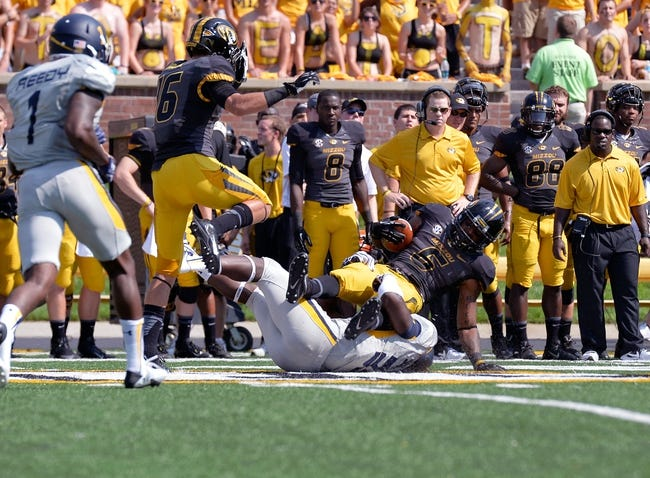 Sep 7, 2013; Columbia, MO, USA;  Missouri Tigers running back Marcus Murphy (6) is tackled during the first half at Faurot Field. Mandatory Credit: Jasen Vinlove-USA TODAY Sports