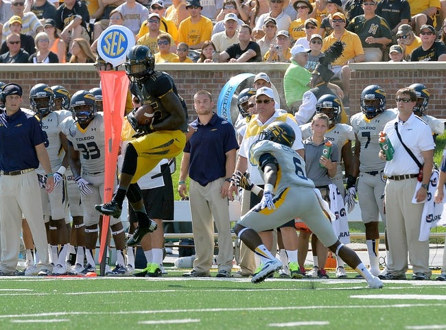 Sep 7, 2013; Columbia, MO, USA;  Missouri Tigers wide receiver Dorial Green-Beckham (15) makes a catch during the first half against the Toledo Rockets at Faurot Field. Mandatory Credit: Jasen Vinlove-USA TODAY Sports