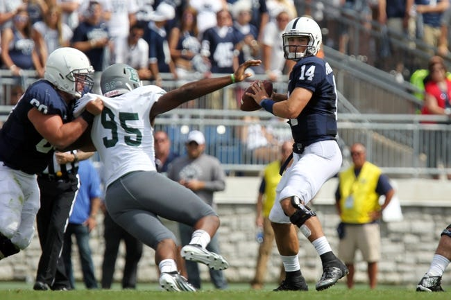 Sep 7, 2013; University Park, PA, USA; Penn State Nittany Lions quarterback Christian Hackenberg (14) drops back to pass the ball during the third quarter against the Eastern Michigan Eagles at Beaver Stadium. Penn State defeated Eastern Michigan 45-7. Mandatory Credit: Matthew O'Haren-USA TODAY Sports