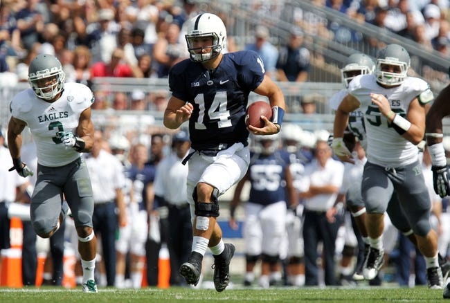 Sep 7, 2013; University Park, PA, USA; Penn State Nittany Lions quarterback Christian Hackenberg (14) runs the ball during the third quarter against the Eastern Michigan Eagles at Beaver Stadium. Penn State defeated Eastern Michigan 45-7. Mandatory Credit: Matthew O'Haren-USA TODAY Sports