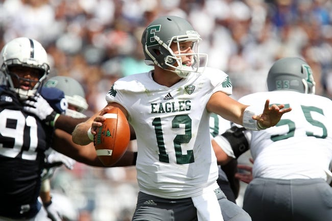Sep 7, 2013; University Park, PA, USA; Eastern Michigan Eagles quarterback Tyler Benz (12) drops back to pass the ball during the third quarter against the Penn State Nittany Lions at Beaver Stadium. Penn State defeated Eastern Michigan 45-7. Mandatory Credit: Matthew O'Haren-USA TODAY Sports