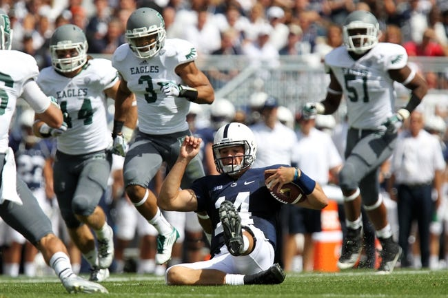 Sep 7, 2013; University Park, PA, USA; Penn State Nittany Lions quarterback Christian Hackenberg (14) slides to avoid a tackle during the third quarter against the Eastern Michigan Eagles at Beaver Stadium. Penn State defeated Eastern Michigan 45-7. Mandatory Credit: Matthew O'Haren-USA TODAY Sports
