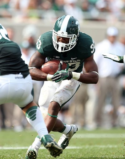 Sep 7, 2013; East Lansing, MI, USA; Michigan State Spartans running back Jeremy Langford (33) runs the ball against the South Florida Bulls during the 2nd half at Spartan Stadium. MSU won 21-6. Mandatory Credit: Mike Carter-USA TODAY Sports