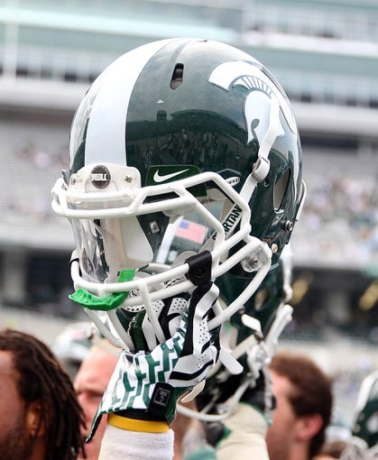 Sep 7, 2013; East Lansing, MI, USA; Close up view of Michigan State Spartans helmet after a game  at Spartan Stadium. Mandatory Credit: Mike Carter-USA TODAY Sports