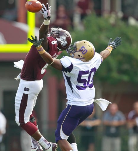 Sep 7, 2013; Starkville, MS, USA;  Mississippi State Bulldogs tight end Malcom Johnson (6) reaches out for a pass thrown on a fake punt as Alcorn State defensive end Kenry Tolbert (50) defends at Davis Wade Stadium. Mandatory Credit: Marvin Gentry-USA TODAY Sports