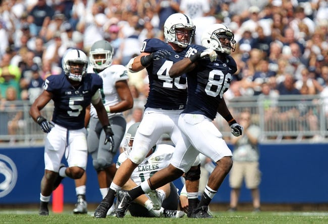 Sep 7, 2013; University Park, PA, USA; Penn State Nittany Lions defensive end C.J. Olaniyan (86) celebrates after a sac during the second quarter against the Eastern Michigan Eagles at Beaver Stadium. Penn State defeated Eastern Michigan 45-7. Mandatory Credit: Matthew O'Haren-USA TODAY Sports