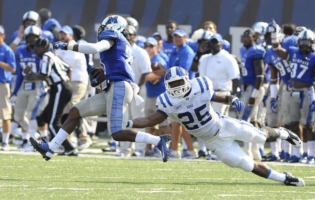 Sep 7, 2013; Memphis, TN, USA;Memphis Tigers defensive back Bobby McCain (21) intercepts a pass thrown by Duke Blue Devils quarterback Anthony Boone (7) at Liberty Bowl Memorial. Mandatory Credit: Justin Ford-USA TODAY Sports
