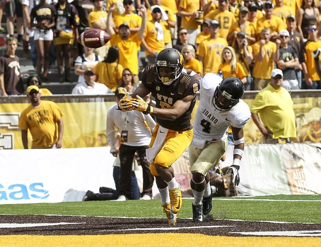 Sep 7, 2013; Laramie, WY, USA; Wyoming Cowboys wide receiver Robert Herron (6) tries to make a catch while defended by Idaho Vandals cornerback Jayshawn Jordan (4) during the first quarter at War Memorial Stadium. Mandatory Credit: Troy Babbitt-USA TODAY Sports