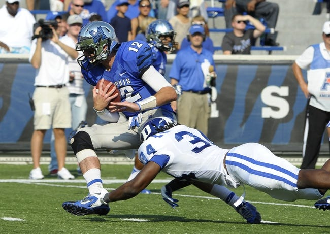 Sep 7, 2013; Memphis, TN, USA; Memphis Tigers quarterback Paxton Lynch (12) is brought down by Duke Blue Devils defensive end Jonathan Woodruff (34) at Liberty Bowl Memorial. Mandatory Credit: Justin Ford-USA TODAY Sports
