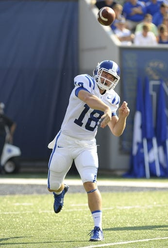 Sep 7, 2013; Memphis, TN, USA; Duke Blue Devils quarterback Brandon Connette (18) throws the ball against the Memphis Tigers at Liberty Bowl Memorial. Mandatory Credit: Justin Ford-USA TODAY Sports