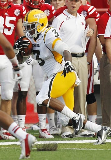 Sep 7, 2013; Lincoln, NE, USA; Southern Mississippi Golden Eagles receiver Tyre Bracken (3) catches the pass against the Nebraska Cornhuskers defender Ciante Evans (17) in the first quarter at Memorial Stadium. Mandatory Credit: Bruce Thorson-USA TODAY Sports