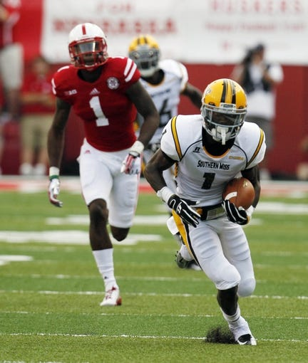 Sep 7, 2013; Lincoln, NE, USA; Southern Mississippi Golden Eagles receiver Tyre'oune Holmes (1) catches a pass against the Nebraska Cornhuskers in the first quarter at Memorial Stadium. Mandatory Credit: Bruce Thorson-USA TODAY Sports
