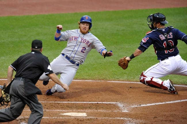 Sep 7, 2013; Cleveland, OH, USA; New York Mets third baseman Justin Turner (2) scores a run before a tag by Cleveland Indians catcher Yan Gomes (10) in the second inning at Progressive Field. Mandatory Credit: David Richard-USA TODAY Sports