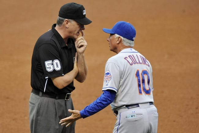 Sep 7, 2013; Cleveland, OH, USA; New York Mets manager Terry Collins (10) argues a call with first base umpire Paul Emmel (50) in the first inning against the Cleveland Indians at Progressive Field. Mandatory Credit: David Richard-USA TODAY Sports