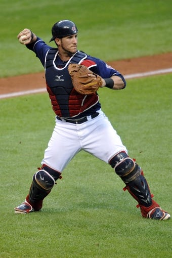 Sep 7, 2013; Cleveland, OH, USA; Cleveland Indians catcher Yan Gomes (10) throws to first base in the second inning against the New York Mets at Progressive Field. Mandatory Credit: David Richard-USA TODAY Sports
