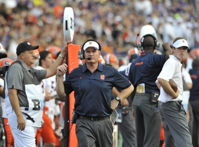 Sep 7, 2013; Evanston, IL, USA; Syracuse Orange head coach Scott Shafer coaches  against the Northwestern Wildcats during the first quarter at Ryan Field. Mandatory Credit: David Banks-USA TODAY Sports