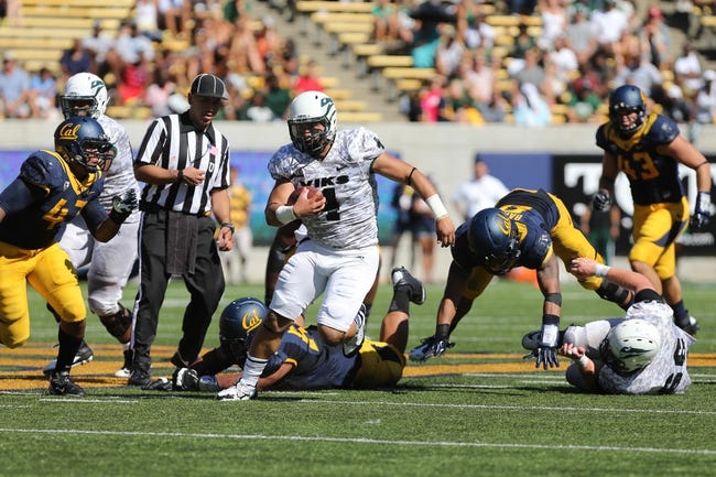 Sep 7, 2013; Berkeley, CA, USA; Portland State Vikings quarterback Kieran McDonagh (4) elects to run against the California Golden Bears during the second quarter at Memorial Stadium. Mandatory Credit: Kelley L Cox-USA TODAY Sports