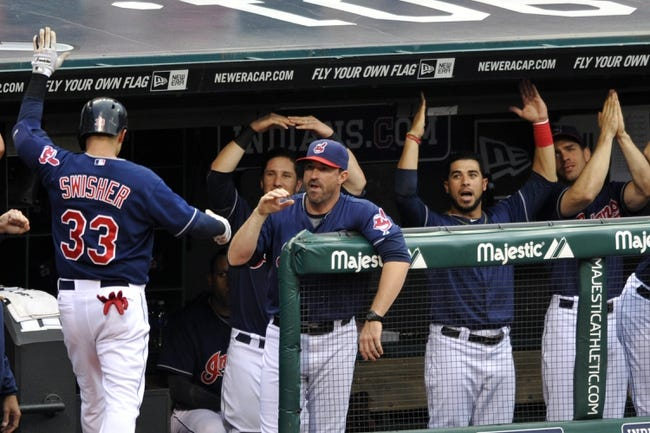 Sep 7, 2013; Cleveland, OH, USA; Cleveland Indians first baseman Nick Swisher (33) celebrates at the dugout after hitting a solo home run in the second inning against the New York Mets at Progressive Field. Mandatory Credit: David Richard-USA TODAY Sports